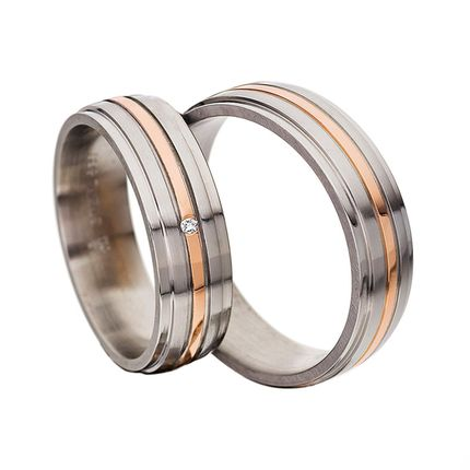 Золотые обручальные кольца с бриллиантом на заказ