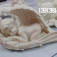 Статуэтка спящего ангелочка.