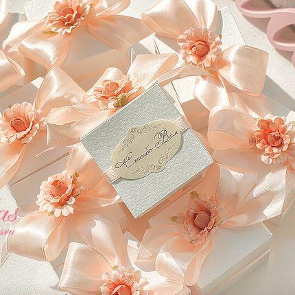 Бонбоньерки для подарков гостям в персиковых тонах