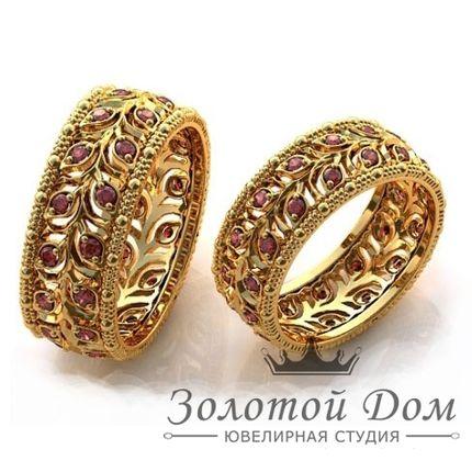 Обручальные кольца ажурные с гранатами