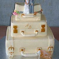 """Торт """"Молодожены"""", украшенный марципановыми фигурками счастливых влюбленных"""