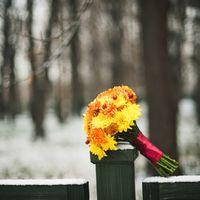 Букет невесты из желтых и оранжевых астр