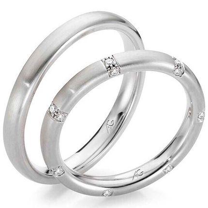 Обручальные кольца из белого золота с 21 бриллиантом. На заказ